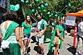 2015 Fremont Solstice parade - green hats for donations 02 (19304613922).jpg