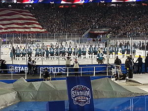 2015 NHL Stadium Series - The Kings and Sharks players  during the pre-game national anthem.