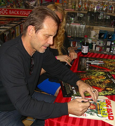 Actor Michael Biehn autographing a copy of Mad #268 (January 1987) which parodies one of Biehn's films, Aliens 8.23.12MichaelBiehnByLuigiNovi11.jpg