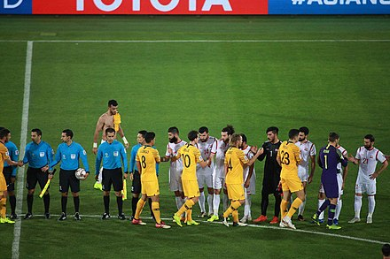 Player greetings prior to kickoff of Australia vs. Syria AUS-SYR 20190116 Asian Cup 13.jpg