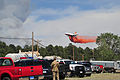 A DC-10 aircraft releases a fire-retardant solution to help stop the spreading of fires in El Paso 130612-Z-WF656-030.jpg