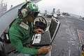 A Sailor performs maintenance on an F A-18 Hornet. (18904414684).jpg