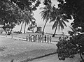 A group of Polynesian children standing on a coastal pathway (AM 75224-1).jpg