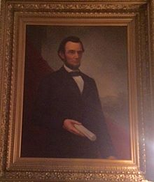 This is a painting of Abraham Lincoln, done by William Cogswell, displayed in the Mabel Tainter Theater
