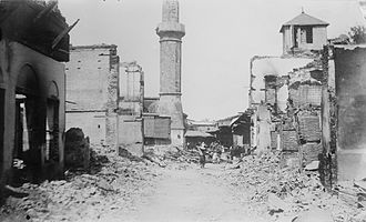 Adana massacre of 1909 - Ruins of a street in the Christian section of Adana. Ottoman government forces fired upon Christians from the minaret at center.