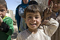 Afghan children smile at GIs -a.jpg