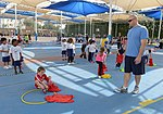 "Airman, soldiers share in ""Sports Day"" with local children 140204-Z-QD538-216.jpg"