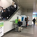 Akihabara Station - public phone and kid with randoseru- Nov 08 2018.jpeg