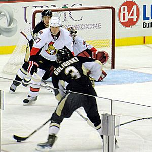 Alex Goligoski - Goligoski scores the game-winning goal in a 2–1 win over the Ottawa Senators while with the Penguins in 2011.