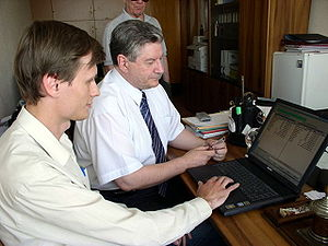 ReactOS - ReactOS project coordinator Aleksey Bragin (left) showing ReactOS to Viktor Alksnis