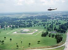 View of helicopter flying over Fort Knox