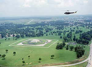 An UH-1 Iroquois helicopter flies over the US Gold Bullion Depository.jpg
