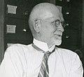 August Foerste in Edward Ulrich office at Smithsonian in July 25, 1933 - public domain photo taken by Ray Bassler.jpg