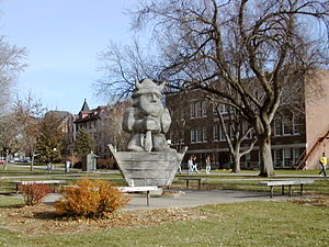 Sioux Falls, South Dakota - Augustana University's mascot, Ole, with the Administration Building, East Hall, and Old Main visible in the background