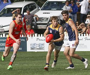 Glossary of Australian rules football - Defensive player giving chase to an attacking player with the ball