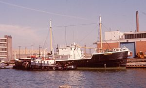 Avalon Voyager and tug moored at the mouth of the Keating Channel.jpg