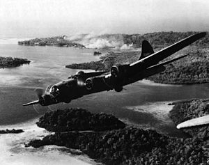 Santo-Pekoa International Airport - Boeing B-17F 41-24457 (Aztec's Curse), 11th Bomb Group, 31st Bombardment Squadron from Pekoa Airfield, Espiritu Santo, flying over Rendova, Solomon Islands 5 October 1942 after a raid of Japanese-held positions on Gizo Island.