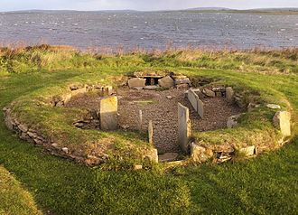 Prehistoric Orkney - House 3 in the Barnhouse Settlement, with Loch of Harray beyond