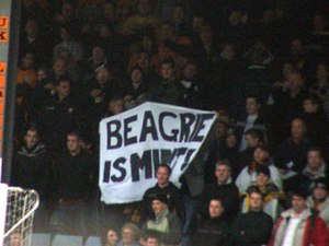 "Peter Beagrie - A banner reads ""Beagrie is Mint!"""
