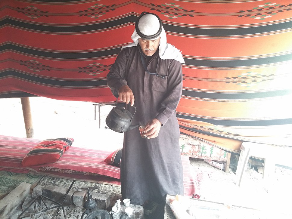 Bedouin man serving tea