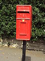 Benkid77 Pole-mounted postbox, Birkenhead 090809.JPG