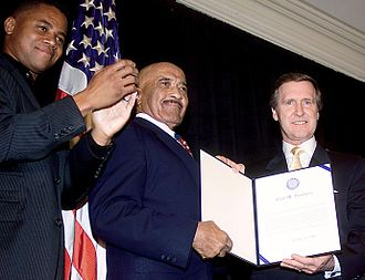 Carl Brashear - Brashear (center) received an Outstanding Public Service Award in October 2000 from actor Cuba Gooding, Jr. and then-Defense Secretary William Cohen for 42 years of combined military and federal civilian service. Gooding portrayed Brashear in the 2000 film Men of Honor.