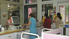 Librarians helping patrons at the circulation desk