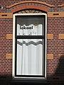 Buren Woonhuis-winkel Peperstraat 11 raam met tekst.jpg