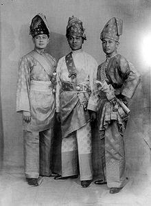 Three men in ceremonial dress