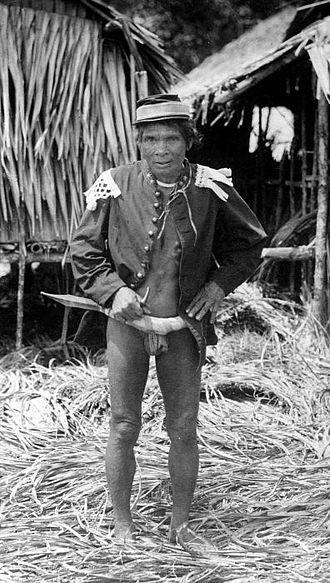 Palitai - A Mentawai man seen with a traditional knife, Palitai at the waist.