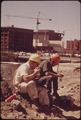 CONSTRUCTION WORKERS TAKE LUNCH BREAK AT SITE OF EXPO '74 SITE OVERLOOKS THE COLUMBIA RIVER - NARA - 548120.tif