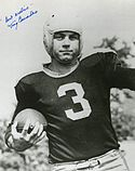 An autographed photo of Tony Canadeo holding a football