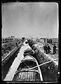 Canal, by old aqueduct near Pisa. These boats bring some of the material for building the American Red Cross concrete village.jpg