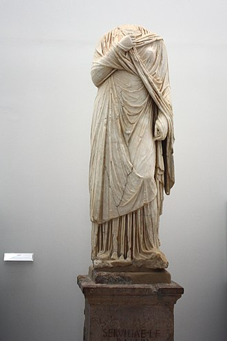 """History of Carmona, Spain - The pedestal on this funerary statue of Servilia bears the dedication: """"To Serviliae, daughter of Lucius, wife of Publius Marius, from her mother."""""""