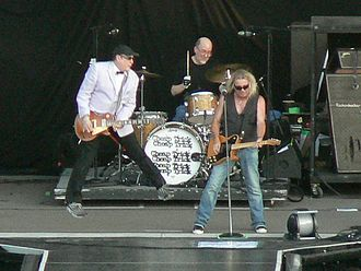 Bun E. Carlos - Nielsen, Carlos and Zander, of the band Cheap Trick, on tour with Def Leppard and Poison in 2009 at the Sleep Train Amphitheater in Marysville, CA