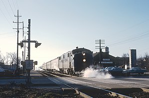 Chicago and Eastern Illinois E7A 1100 with the Danville - Chicago Flyer stopped at the Steger, Illinois depot on Novemebr 26, 1965 (24136487626).jpg