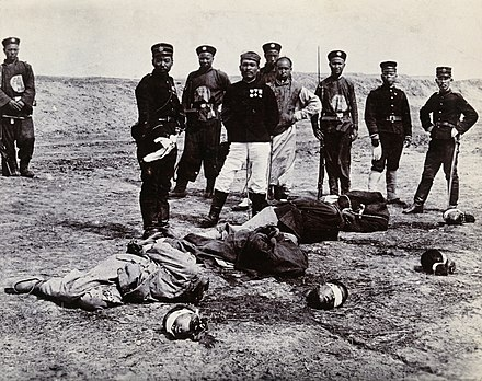Boxers beheaded in front of a group of Chinese and Japanese officials China; the bodies and heads of four men who have been Wellcome V0031251.jpg