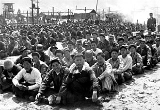Prisoner-of-war camp - North Korean and Chinese Communist prisoners assembled at the United Nations' prisoner-of-war camp at Pusan during the Korean War in 1951