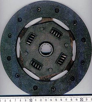 Clutch - Single dry-clutch friction disc. The splined hub is attached to the disc with springs to damp chatter.