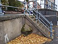 Concrete water table at the junction of Westwick Street and St Benedict's Street, Norwich.jpg