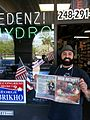 Congressional candidate George Brikho in front of his Madison Heights store.jpg