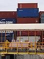Containers with Men Moving Goods - Port Area - Stone Town - Zanzibar - Tanzania (8830684256).jpg