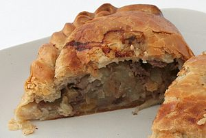 A Cornish pasty made by Warrens cut in half. T...