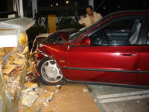 A Honda Accord which crashed into a small guar...