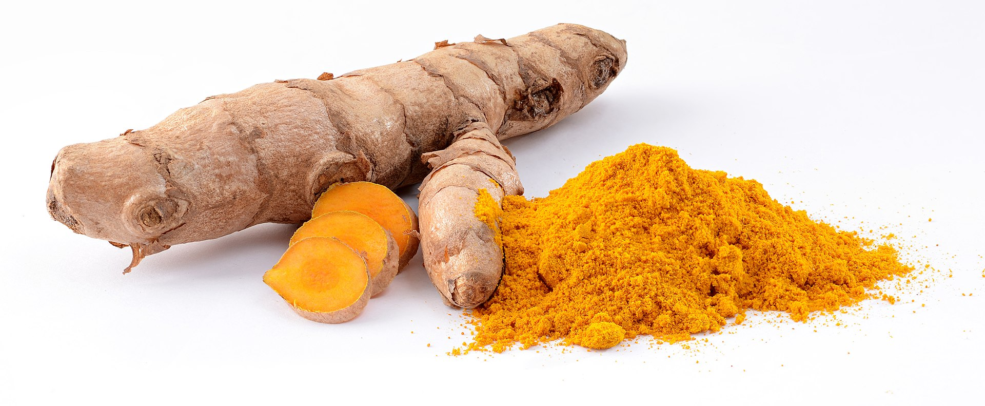 Photograph of knobby brown rhizome and orange powder