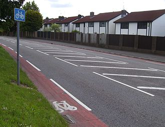 Cycling in Cardiff - Example from Excalibur Drive of the red cycle lanes used in Cardiff.