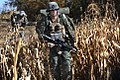 Defense.gov News Photo 101123-M-7110J-025 - U.S. Marine Corps Lance Cpl. Zachary Allen right walks through a corn field during an operation near Forward Operation Base Jackson Afghanistan.jpg