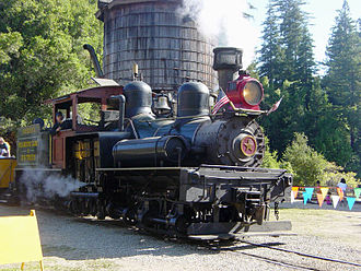 Tender (rail) - Shay locomotive Dixiana at the Roaring Camp and Big Trees Narrow Gauge Railroad, Felton, California, with wooden water tower and extendable spigot visible in the background