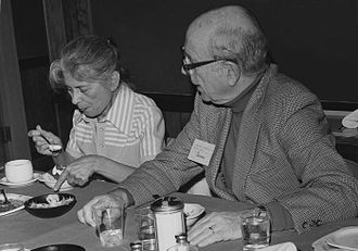 Alexander Langmuir - This photograph depicts Dr. Alexander D. Langmuir seated beside Ms. Ida Sherwood during an Epidemic Intelligence Service (EIS) luncheon.