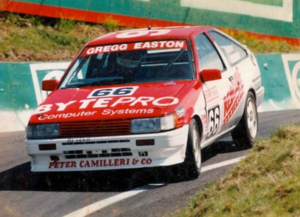 """Gregg Easton - Gregg Easton steers his Toyota through """"The Dipper"""" at Mount Panorama in the 1993 Bathurst 1000"""